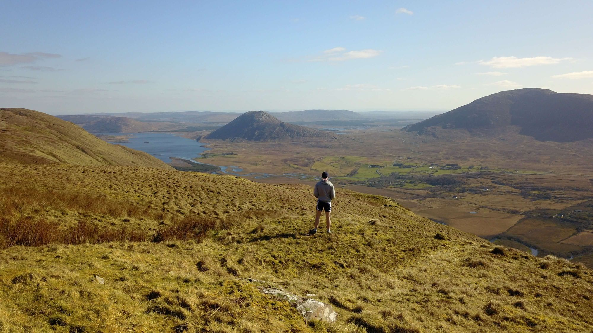 Eamon Keane looking out over Maum valley from the top of Log na Brice Mountain